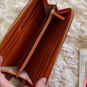 Michael Kors Bags - Michael Kors Orange Large Wallet
